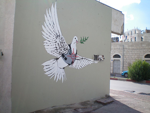 Peace dove by bansky 15 Memorable Street Art Masterpieces by Banksy