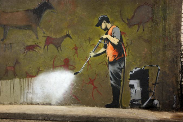 graffiti removal banksy 15 Memorable Street Art Masterpieces by Banksy
