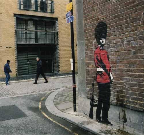 pissing guard graffiti art1 15 Memorable Street Art Masterpieces by Banksy