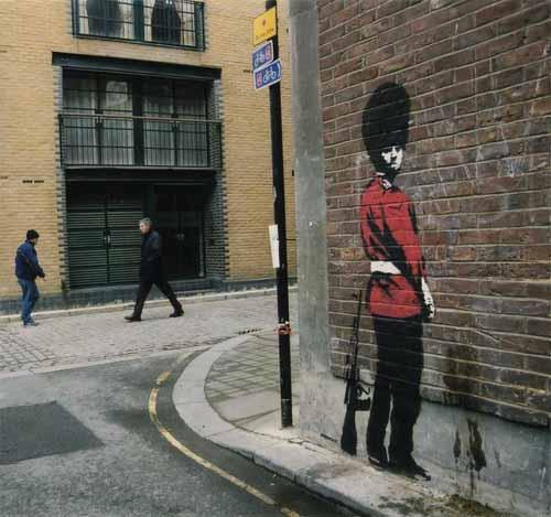 pissing guard graffiti art1 15 Memorable Street Art Masterpieces by Banksy