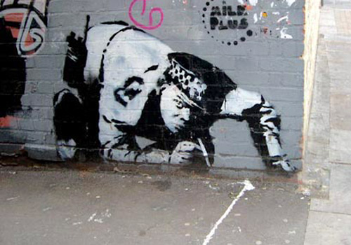 police officer graffiti banksy 15 Memorable Street Art Masterpieces by Banksy