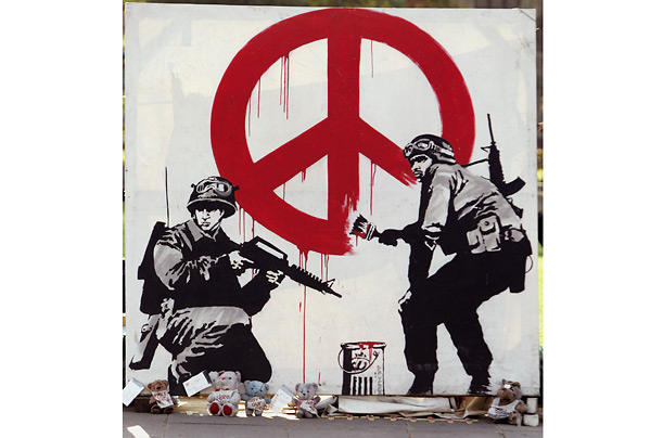 world peace graffiti banksy 15 Memorable Street Art Masterpieces by Banksy